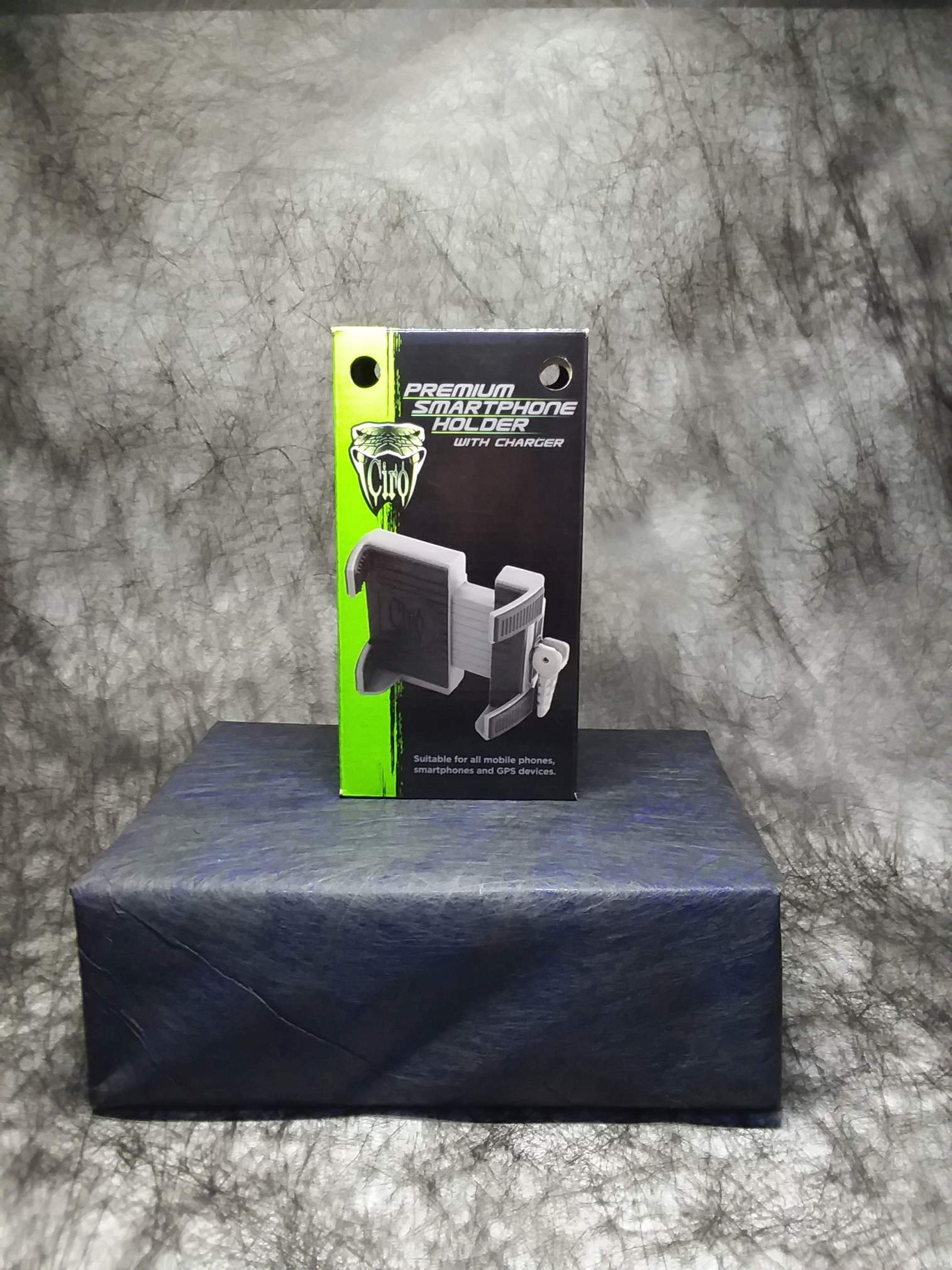 Pictured is the Ciro 3D Premium Smartphone Holder box, black with a green stripe down the left. The Ciro logo and mount appear on the front.