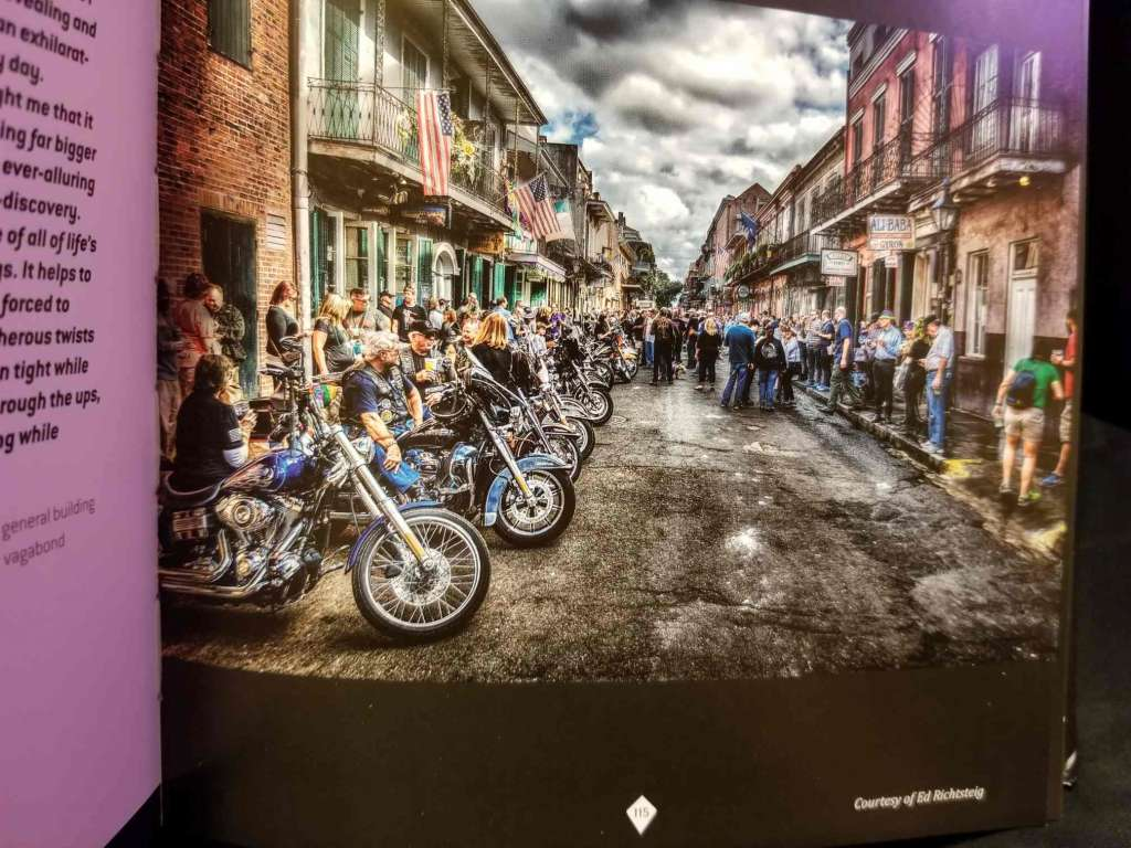 Motorcycle rally street scene, The Meaning of Life According to Bikers, page 115.