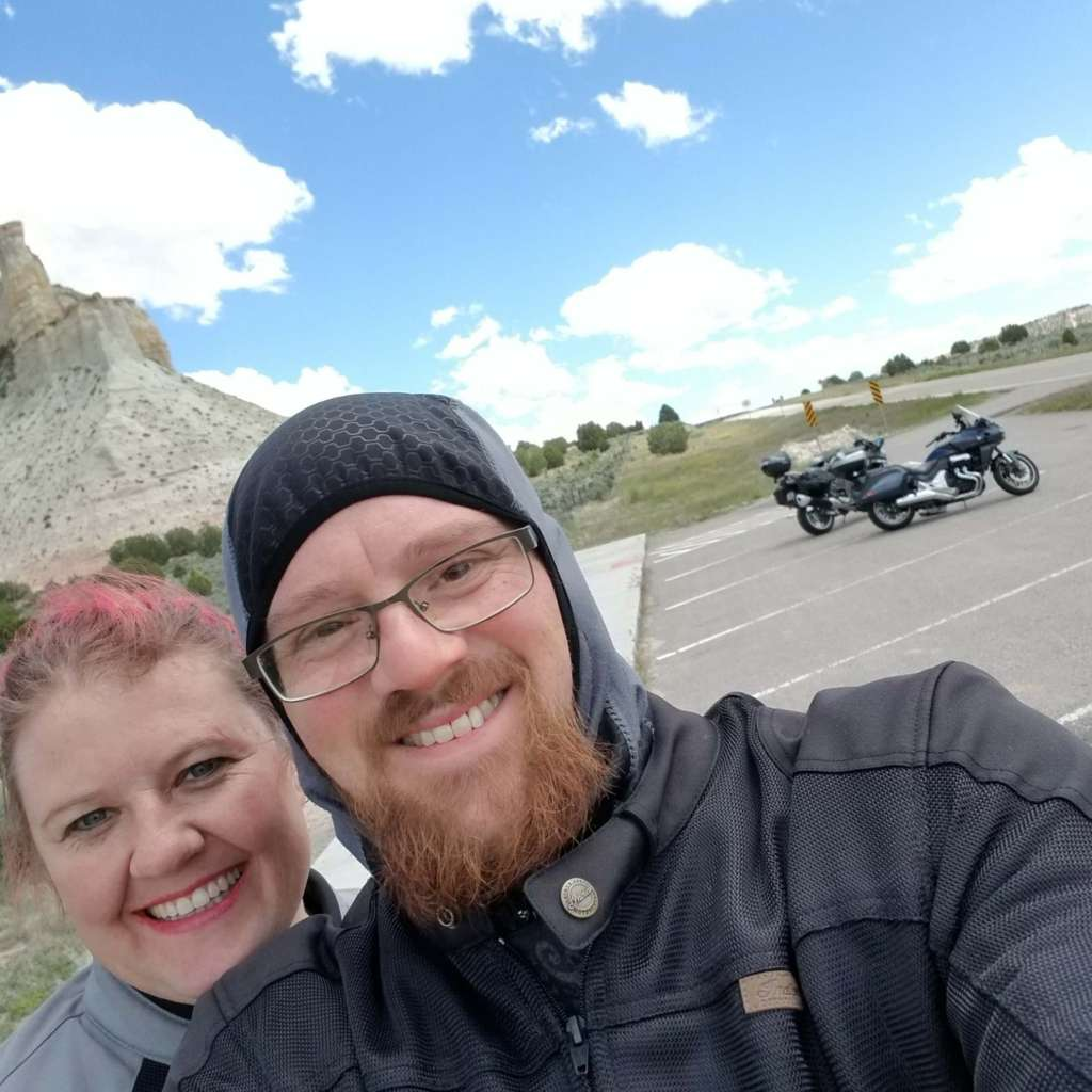 Staff writers Eric and Carrie Leaverton are pictured in a scenic enviornemnt. Eric is wearing a gray and black balaclava.