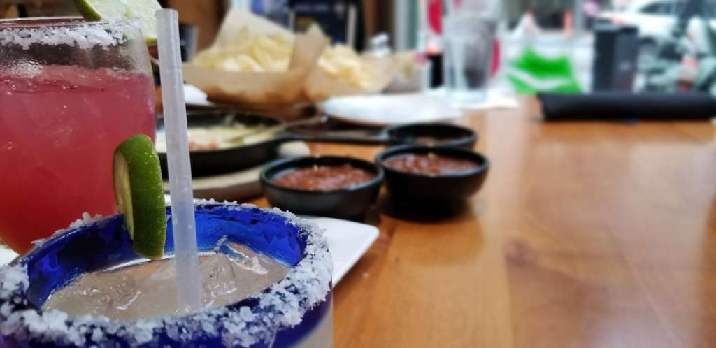 Pictured is a delicious TexMex meal, with salted margaritas in the extreme foreground.
