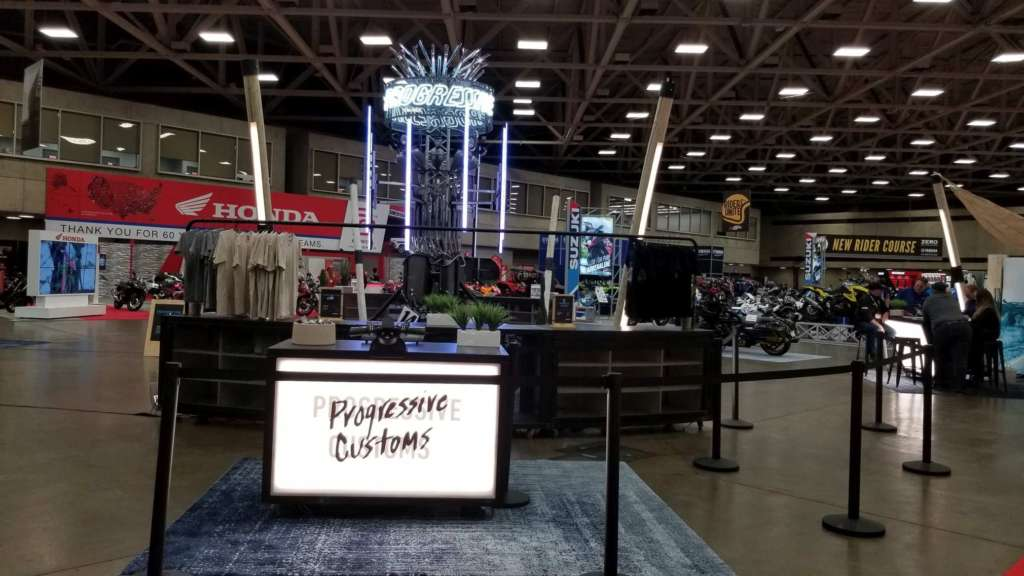 The custom bike show booth at IMS 2020.