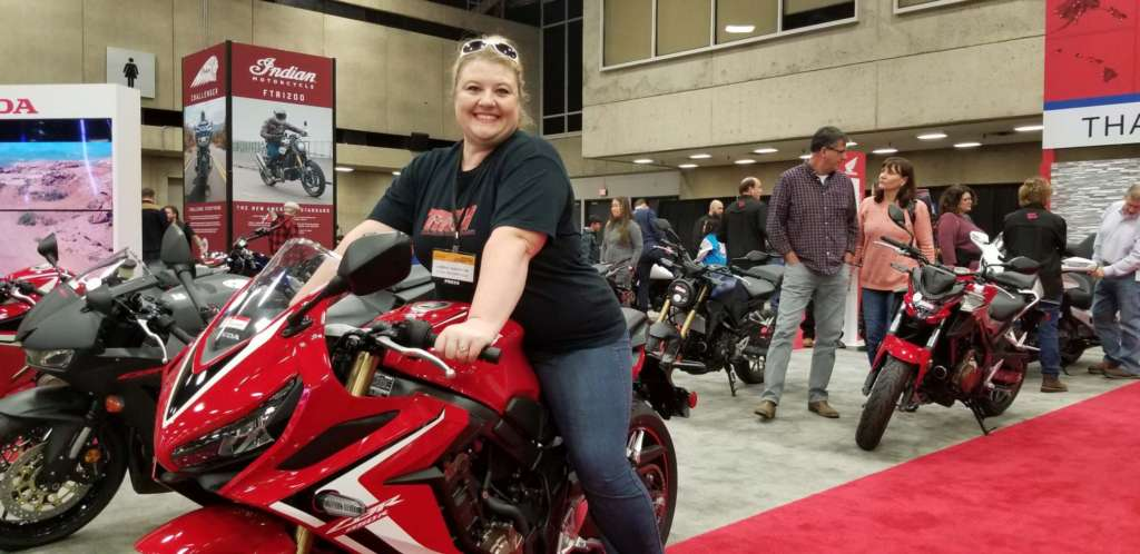 Carrie sitting astride the 2020 CB650R.