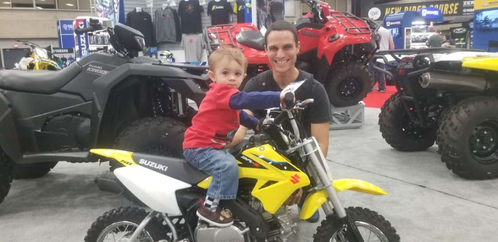 Father and son pose with the Suzuki DR-Z50.