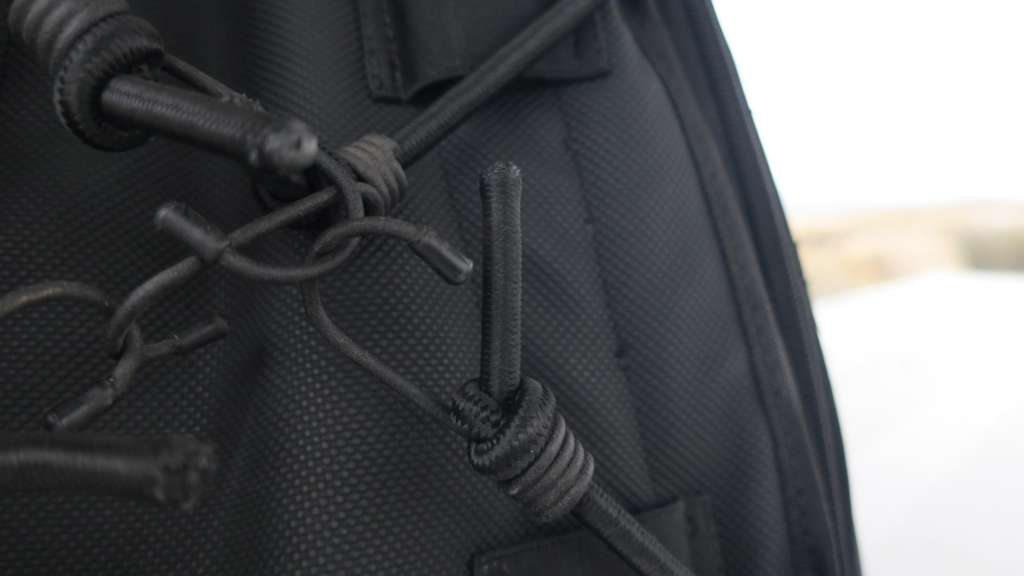 This image is a close-up of the plastic coated bungees on the underside of the Viking Sport Tail Bag.