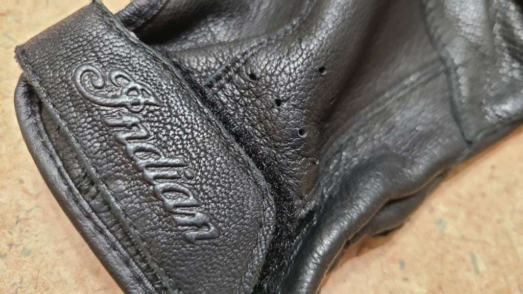 An Indian Summer Ep7 - Luxurious Leather Extreme close-up of the Indian logo on the Classic Women's Riding Glove.