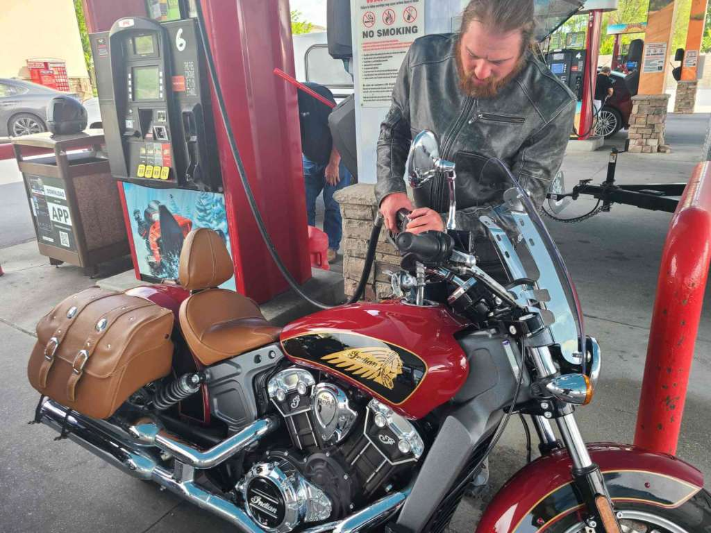 Staff writer Eric Leaverton fueling the 2019 Indian Scout.