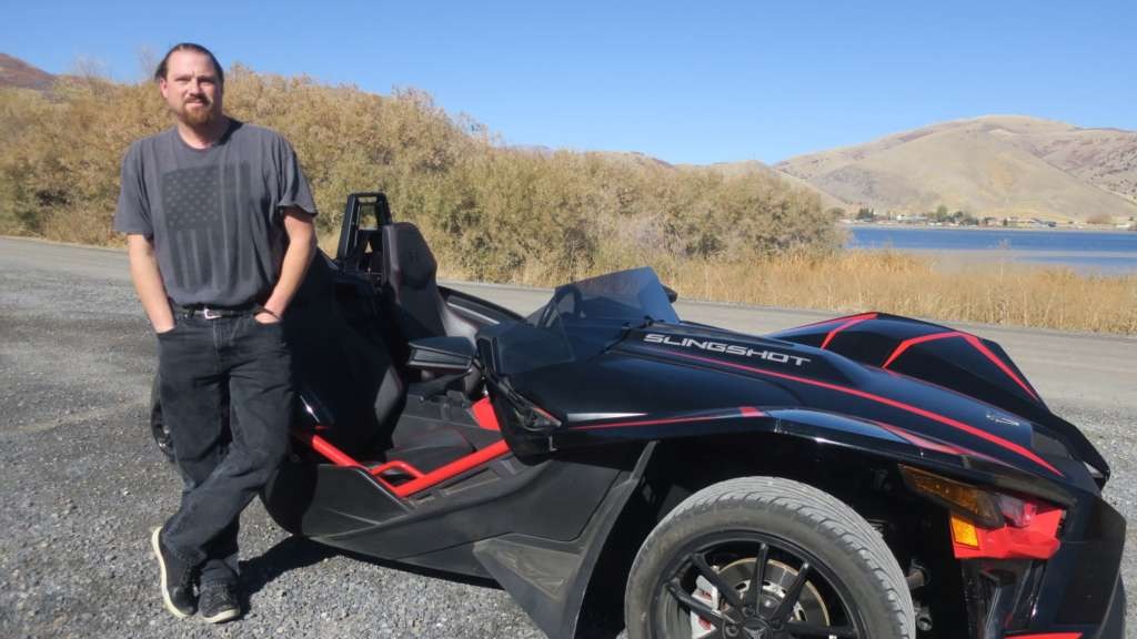Staff writer Eric Leaverton stands next to the Slingshot R.