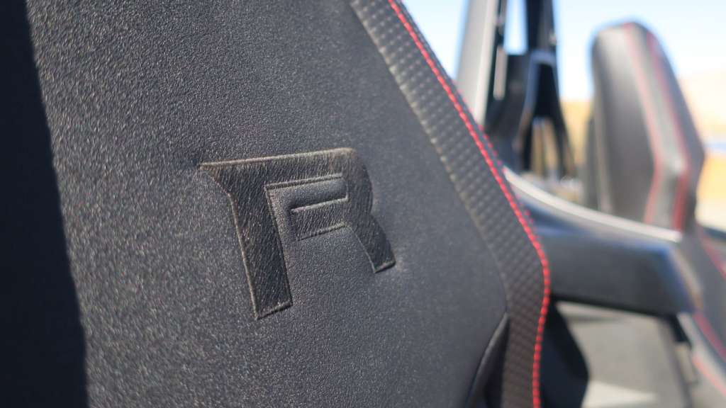 """Close-up of the """"R"""" logo embroidered on the seat of the Slingshot, showing the tight finish of of the stitching."""