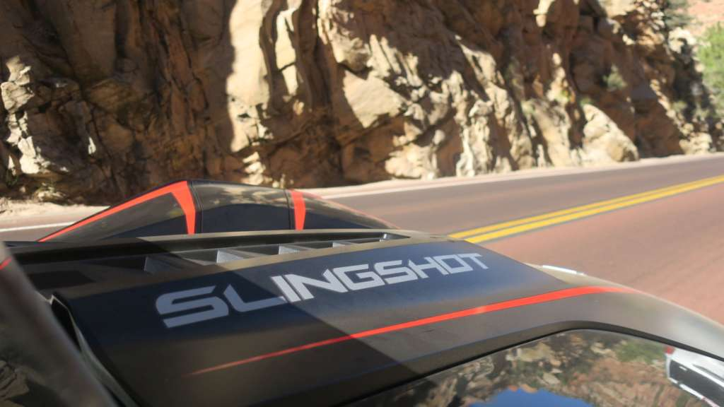 """The hood of the Slingshot R from the passenger seat, from TMW's review. Highlighted is the bright silvered """"Slingshot"""" text running down the hood, and the aggressive vents up the middle."""